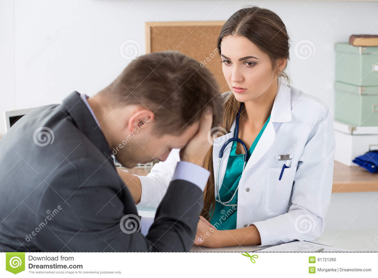 Friendly Female Medicine Doctor's Holding Male Patient's