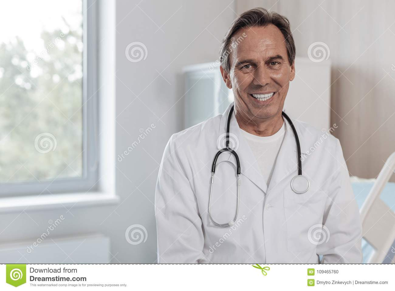 Friendly medical worker grinning broadly into camera