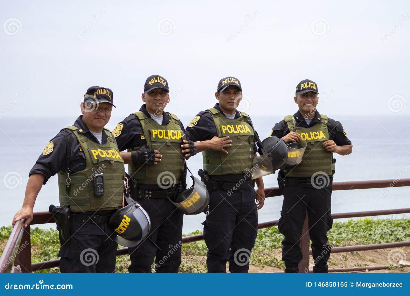 Friendly Peruvian police men smiling in Miraflores