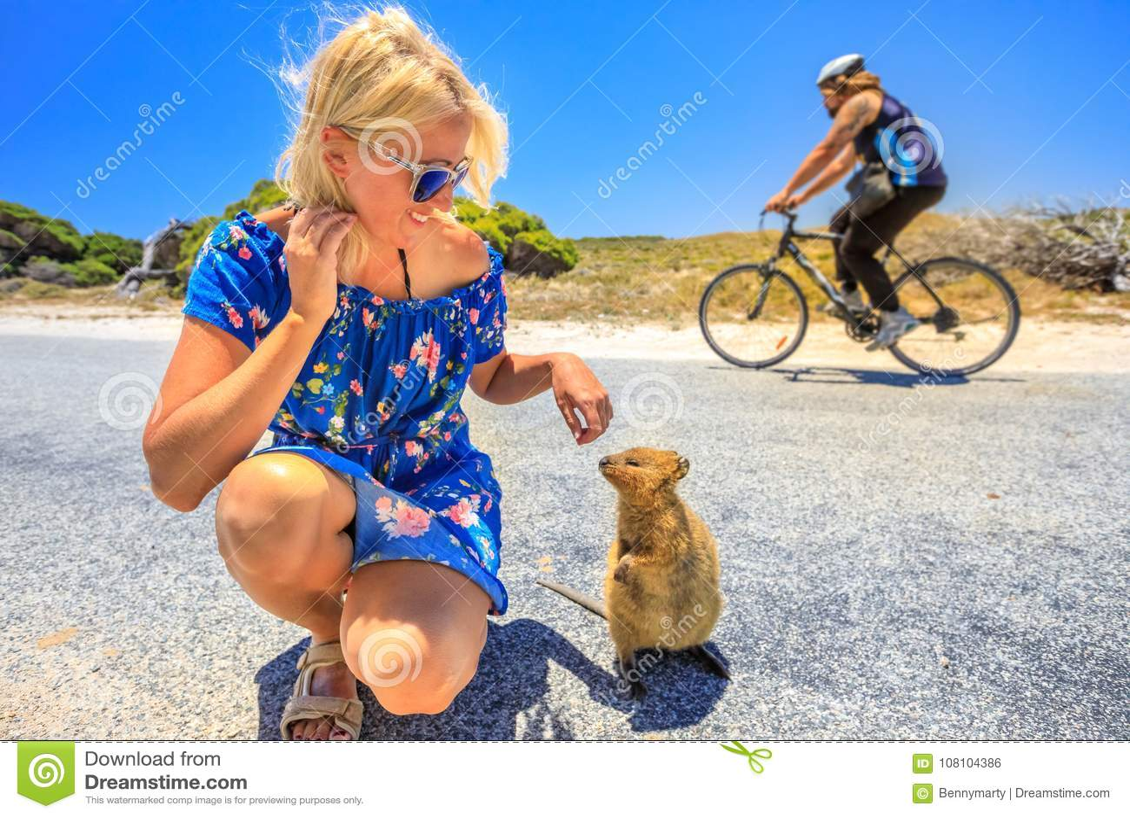 Tourist woman with Quokka