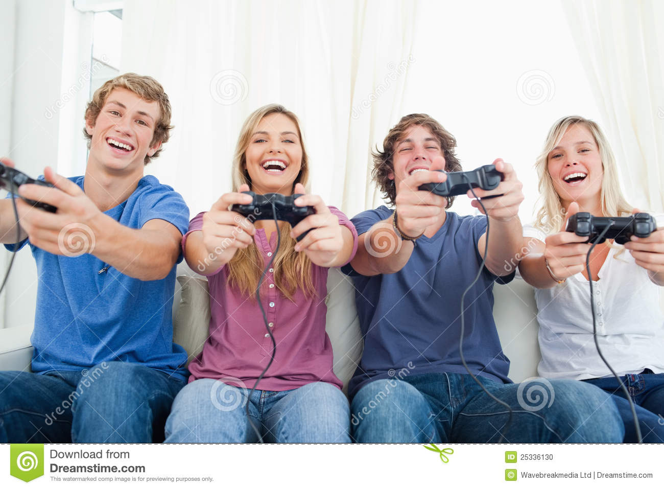 group of friends all playing video games together and smiling