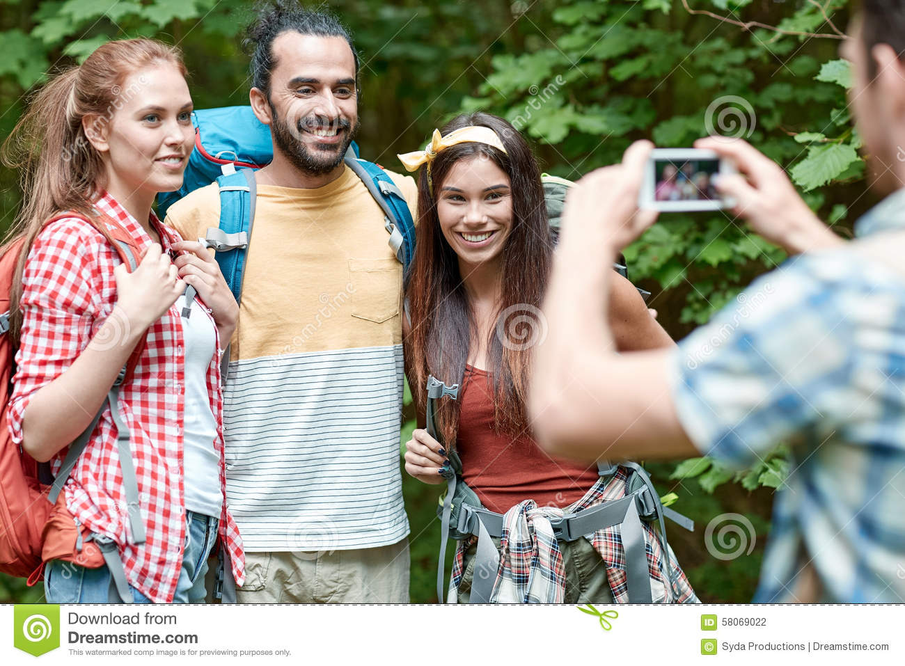 3e00b966e0 Friends With Backpack Photographing By Smartphone Stock Photo ...