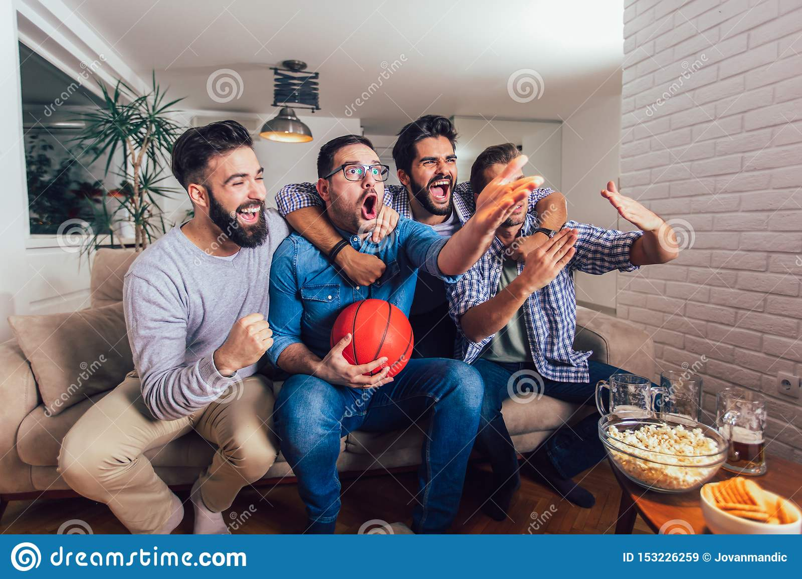 Friends Or Basketball Fans Watching Basketball Game On Tv And Celebrating Victory At Home Friendship Sports And Stock Image Image Of Home Guys 153226259