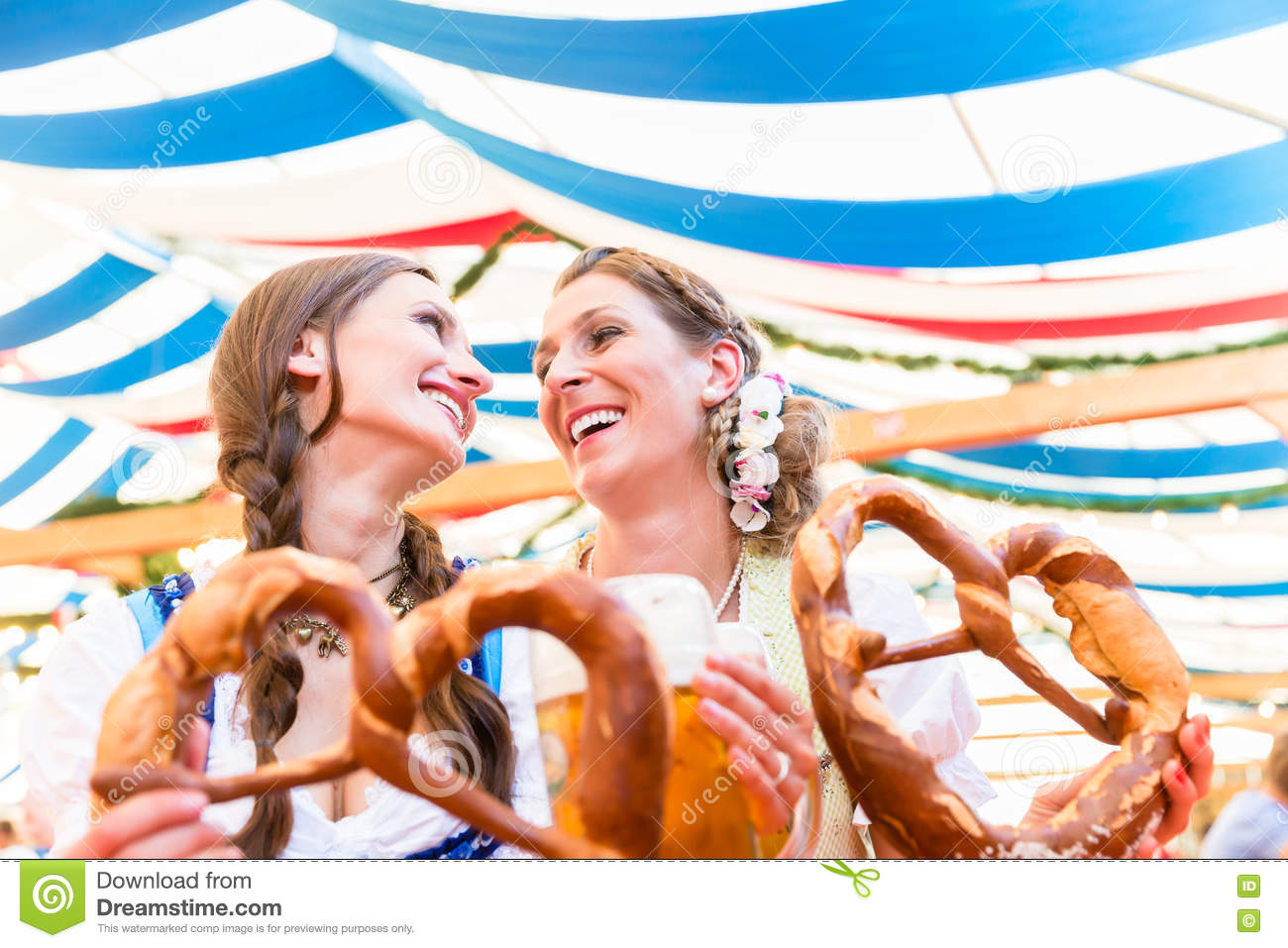 Friends at Bavarian Fair with giant pretzels