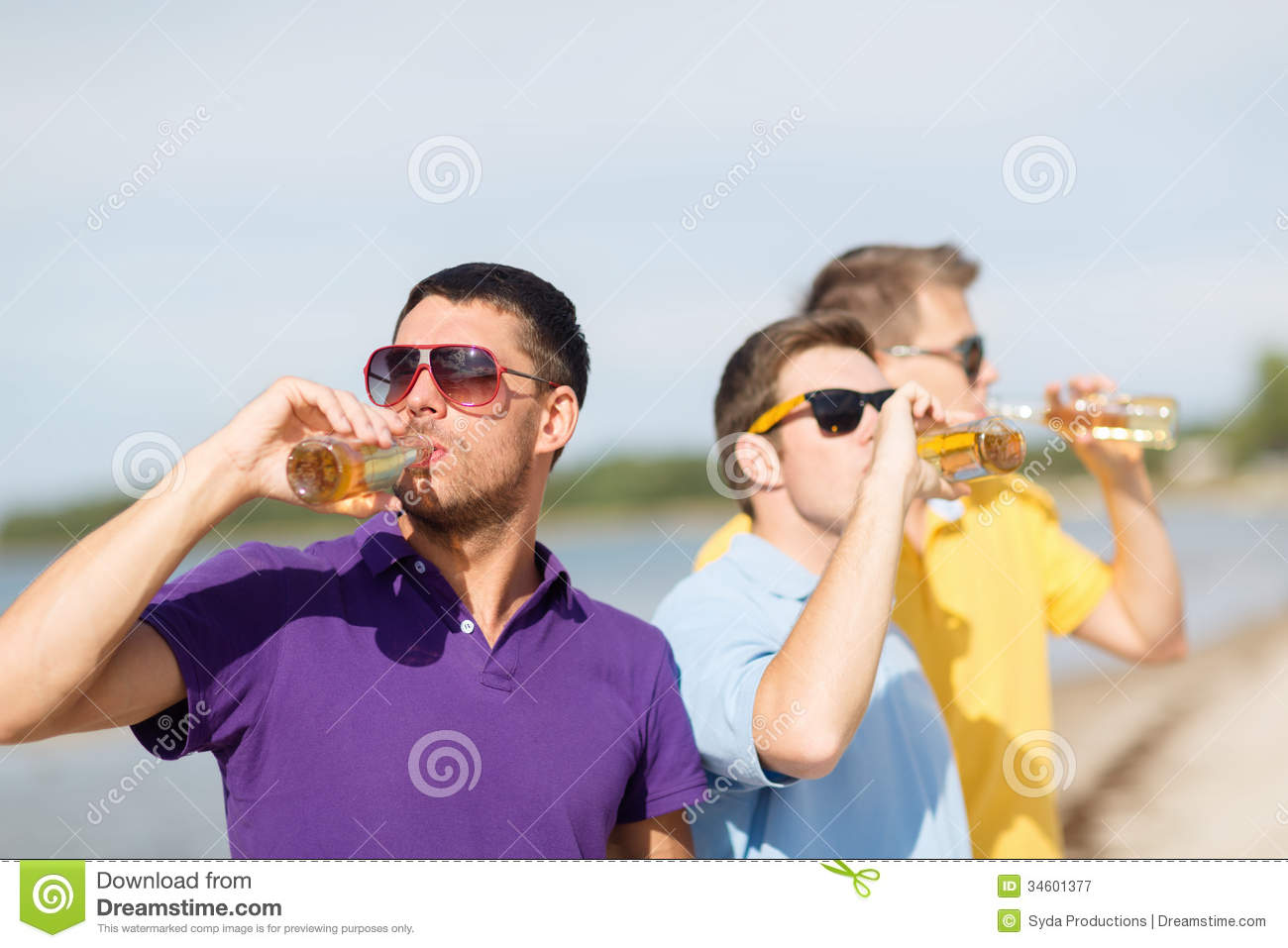 Friends On The Beach With Bottles Of Drink Royalty Free ...
