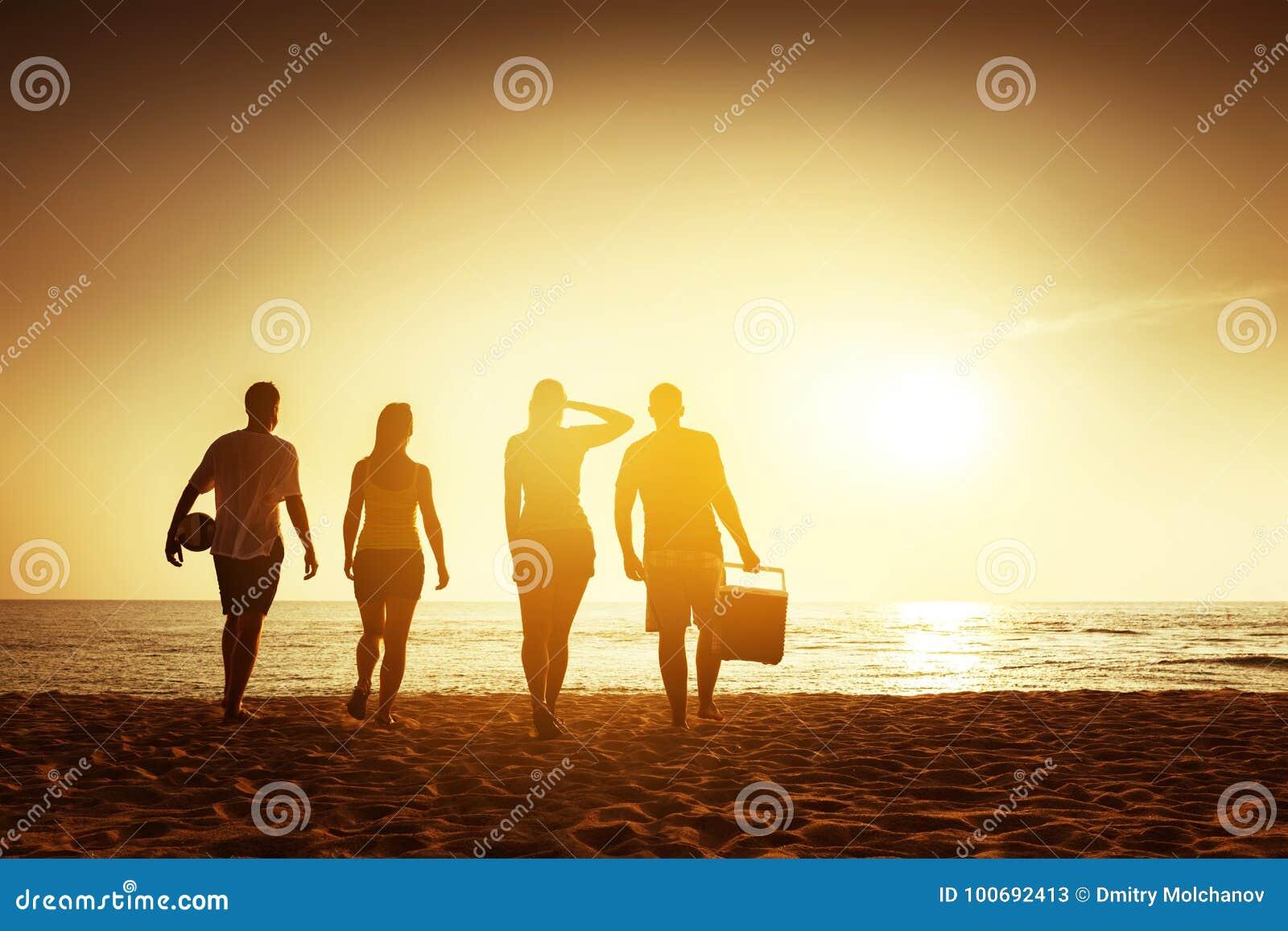 Friends beach sunset concept with stuff