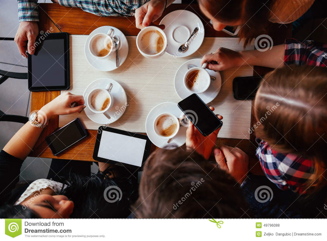 Friends In Cafe Drinking Coffee Stock Photo - Image: 49796088