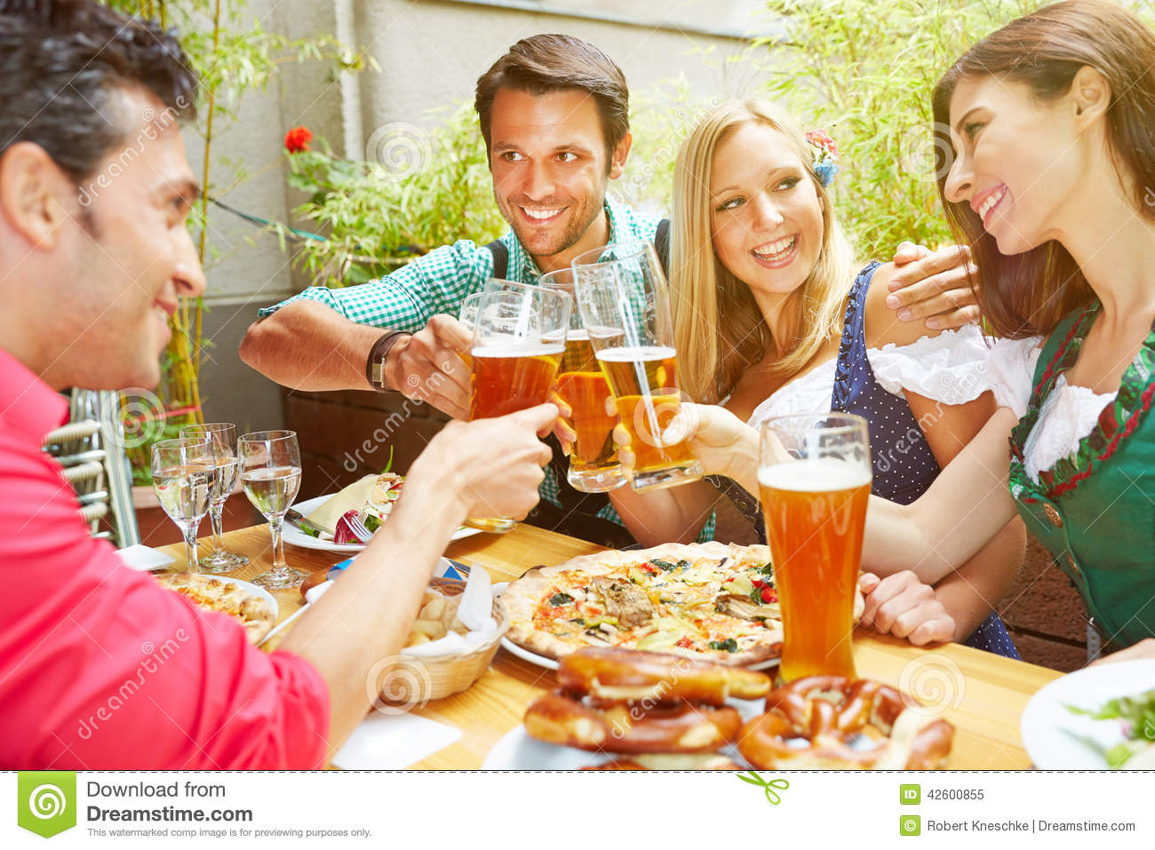 Friends celebrating with beer
