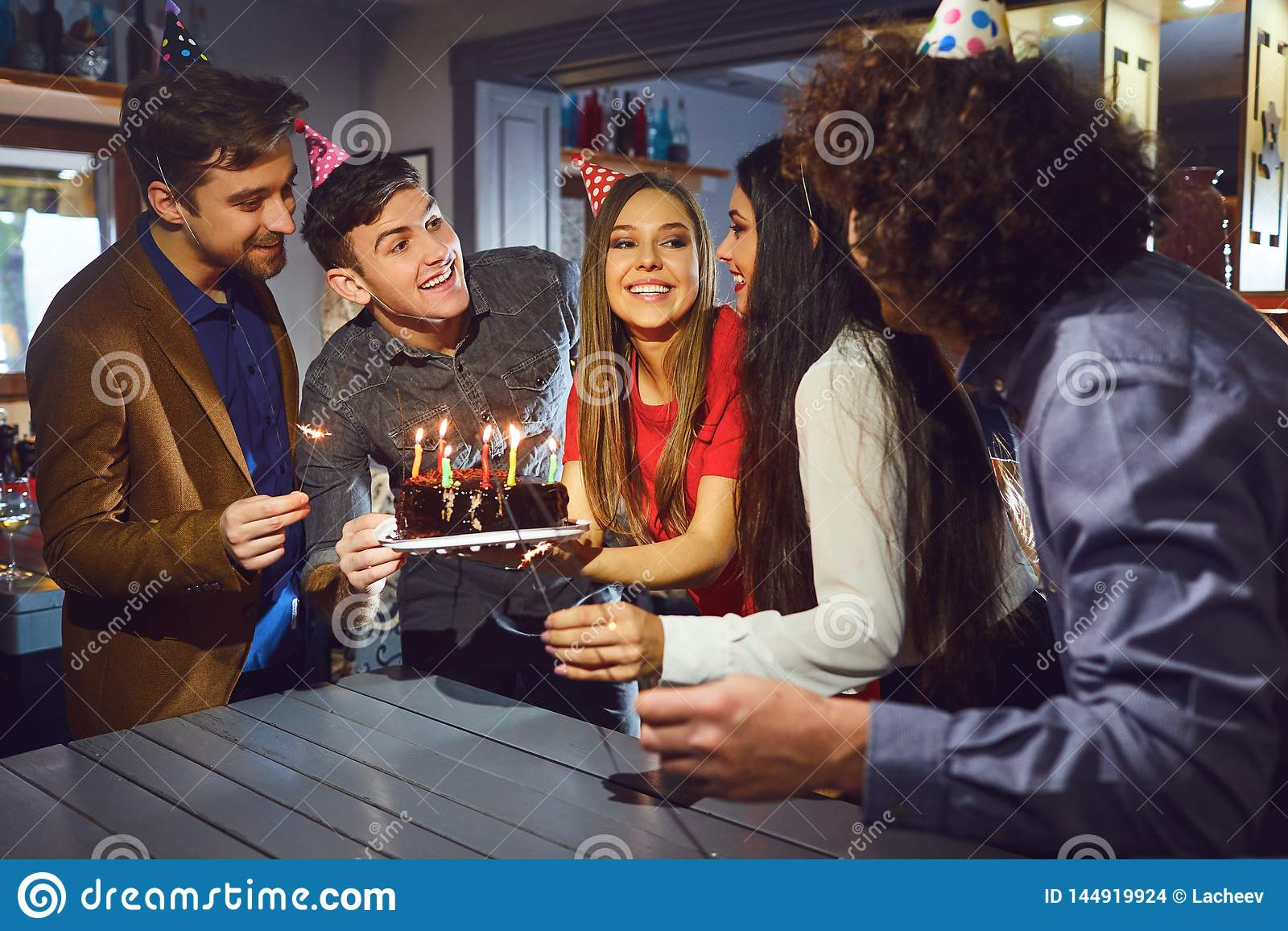 Friends celebrating birthday party indoors