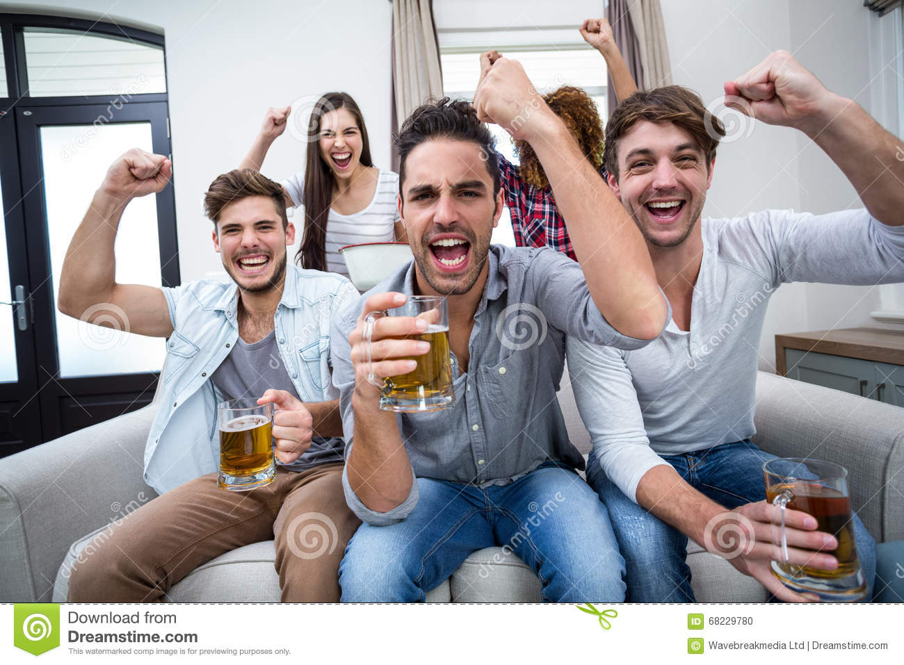 Friends Cheering And Drinking Alcohol While Watching ...