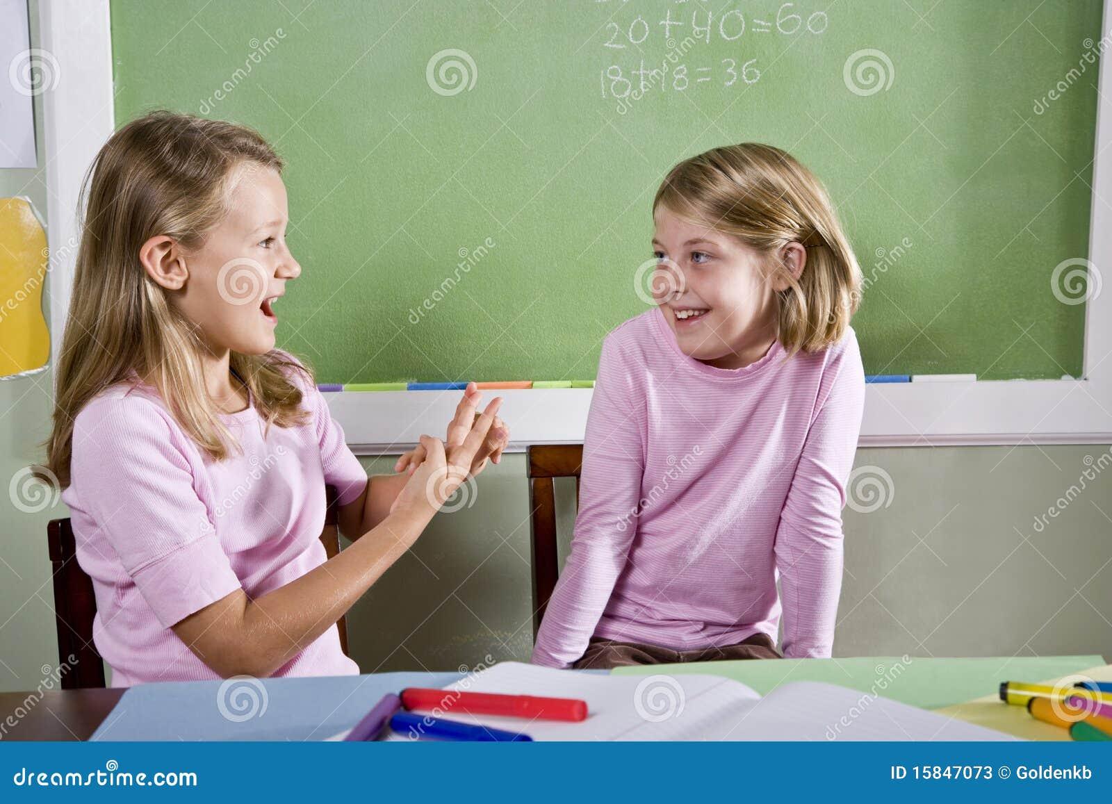 Friends in class talking