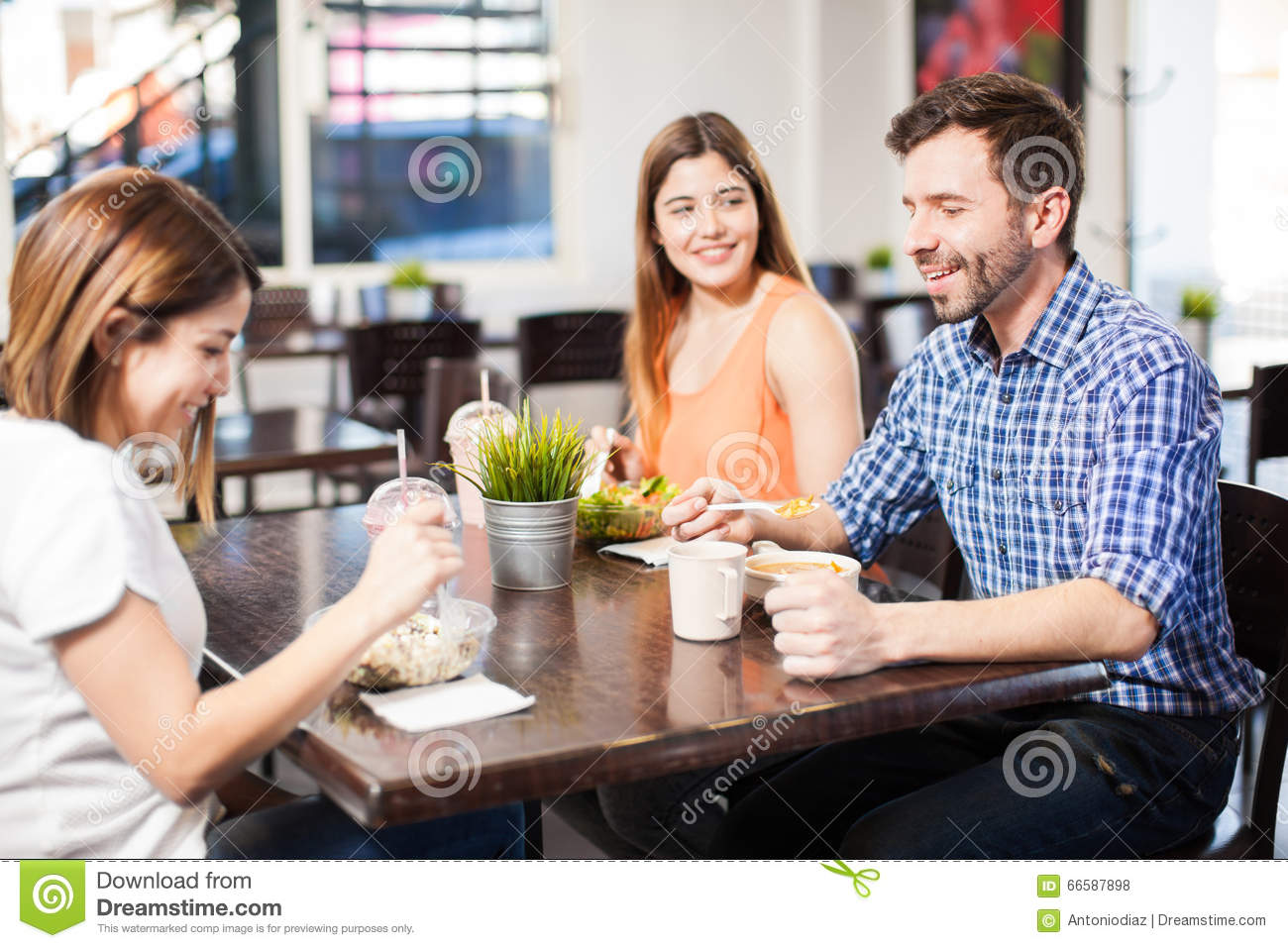 Friends eating lunch at a restaurant stock photo image for Group lunch