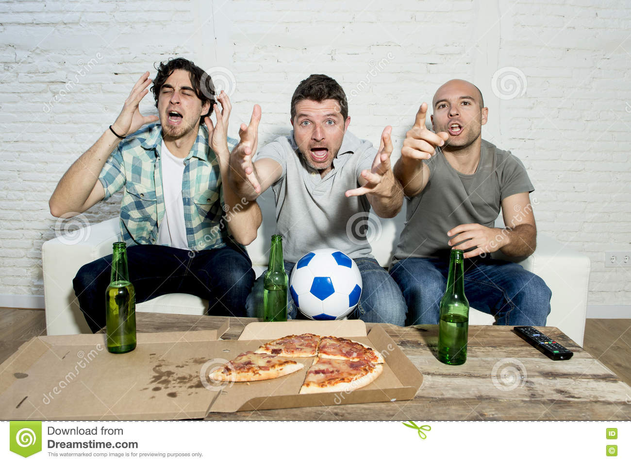 Fans taking pictures with cell phone behind barrier stock photo - Friends Fanatic Football Fans Watching Tv Match With Beer Bottles And Pizza Suffering Stress Royalty Free