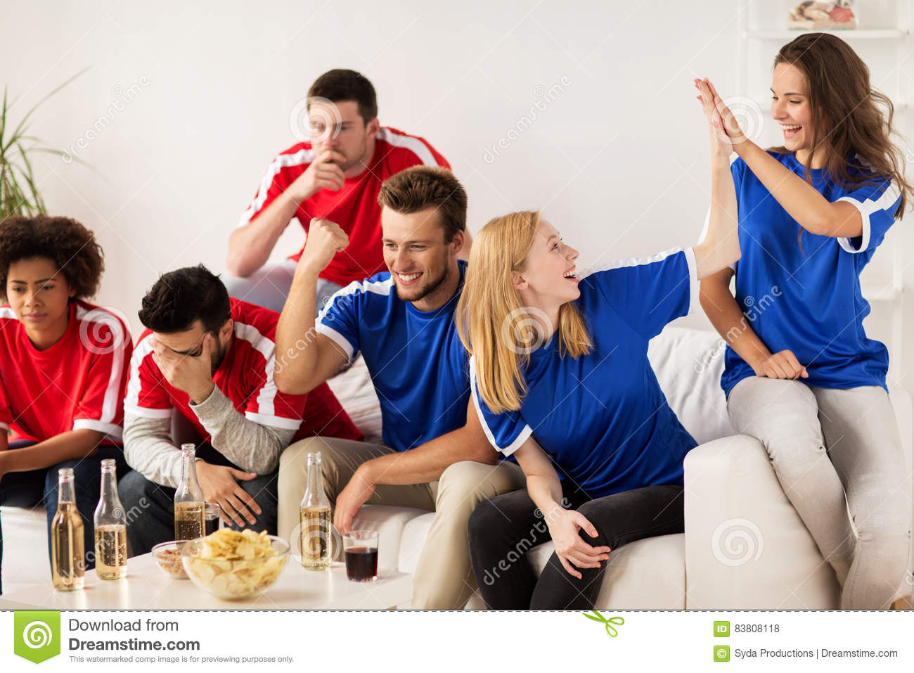 Friends Or Football Fans Watching Soccer At Home Royalty
