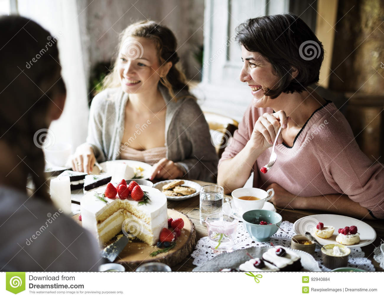 Download Friends Gathering Together On Tea Party Eating Cakes Enjoyment H Stock Photo - Image of reception, delicious: 92940884