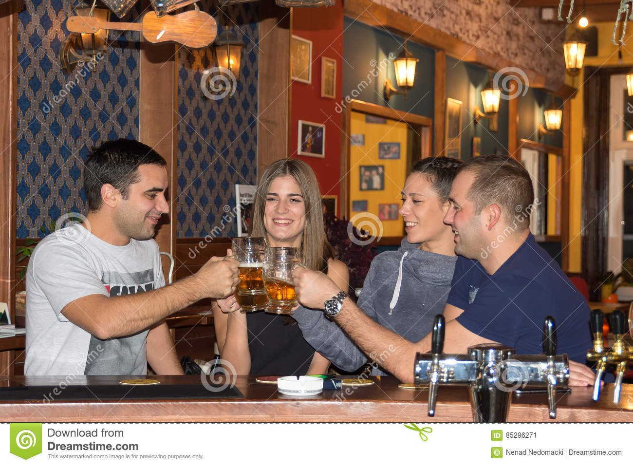 Friends having drinks in a bar