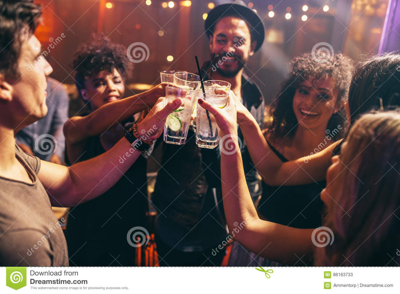 Friends having drinks at the night club party
