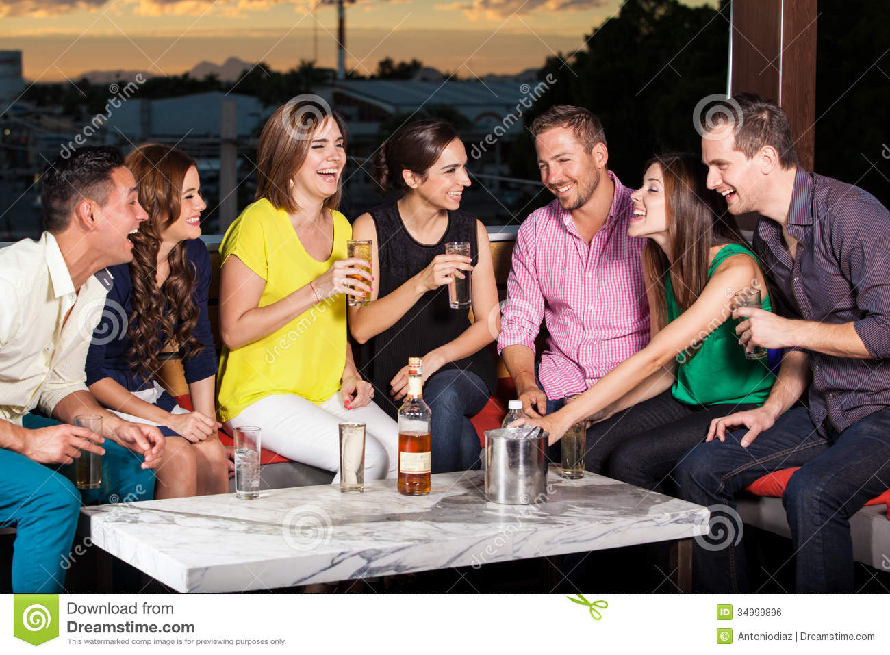 Friends having drinks at sunset stock photo image 34999896 for The terrace group