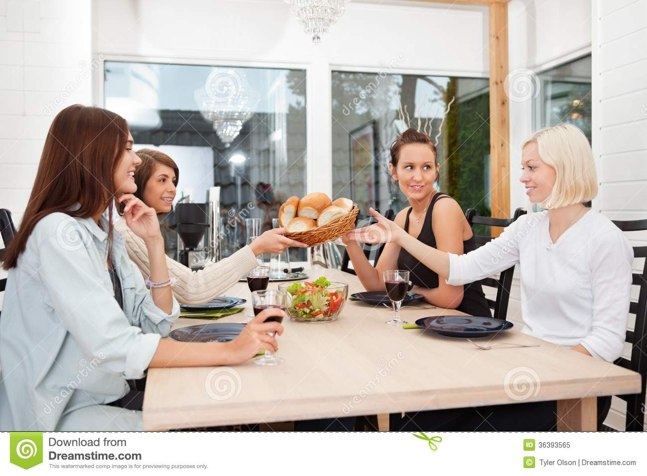 Friends Having Food And Drink At Home Royalty Free Stock