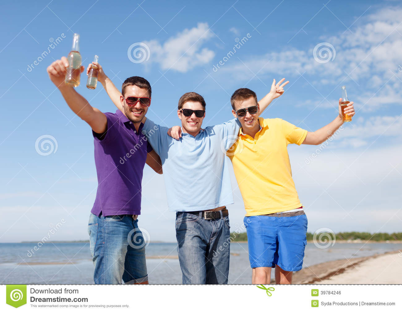 Friends Having Fun On Beach With Bottles Of Beer Stock