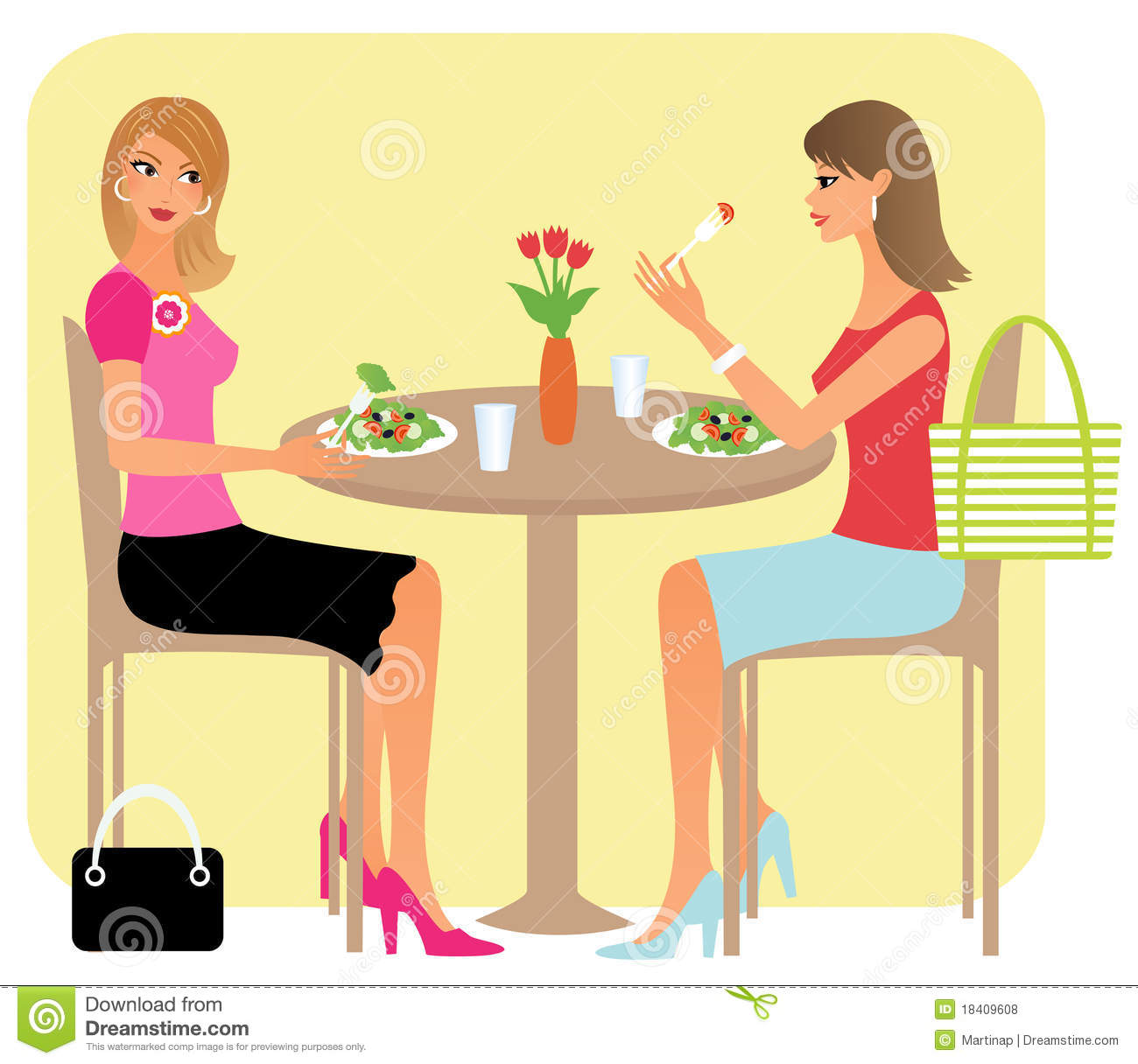 Two attractive girl-friends chatting over their lunch in a restaurant.