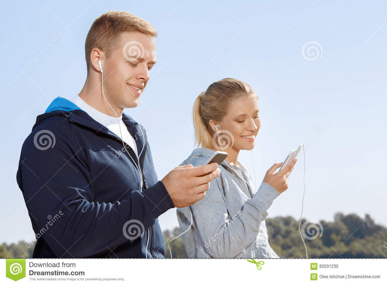 Friends Listening To Music On Their Headphones Stock Photo ...