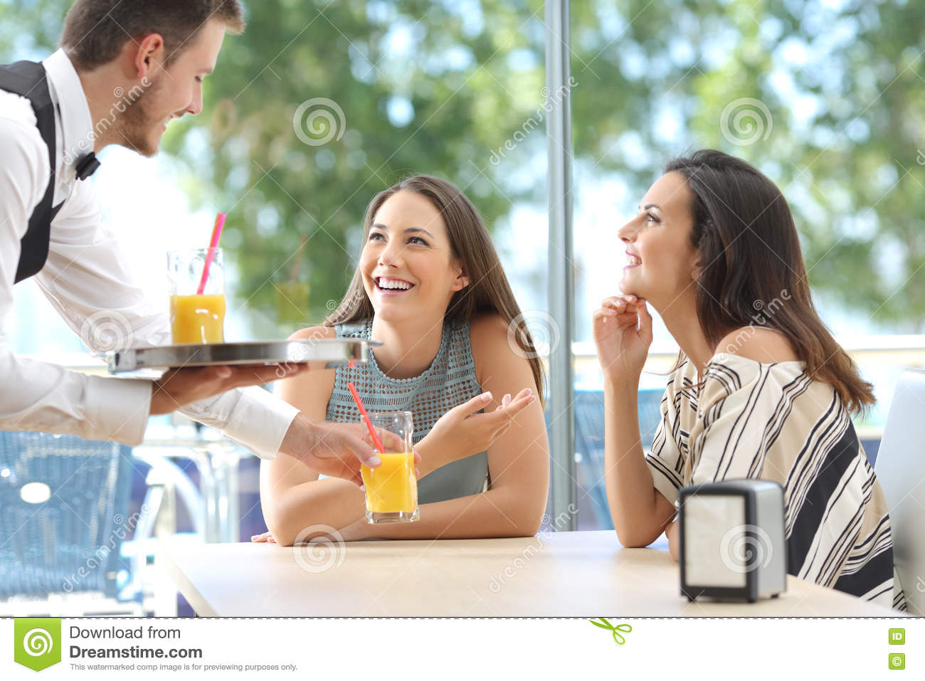 Download Friends Meeting In A Bar With A Waiter Serving Stock Photo - Image of drink, funny: 80697946