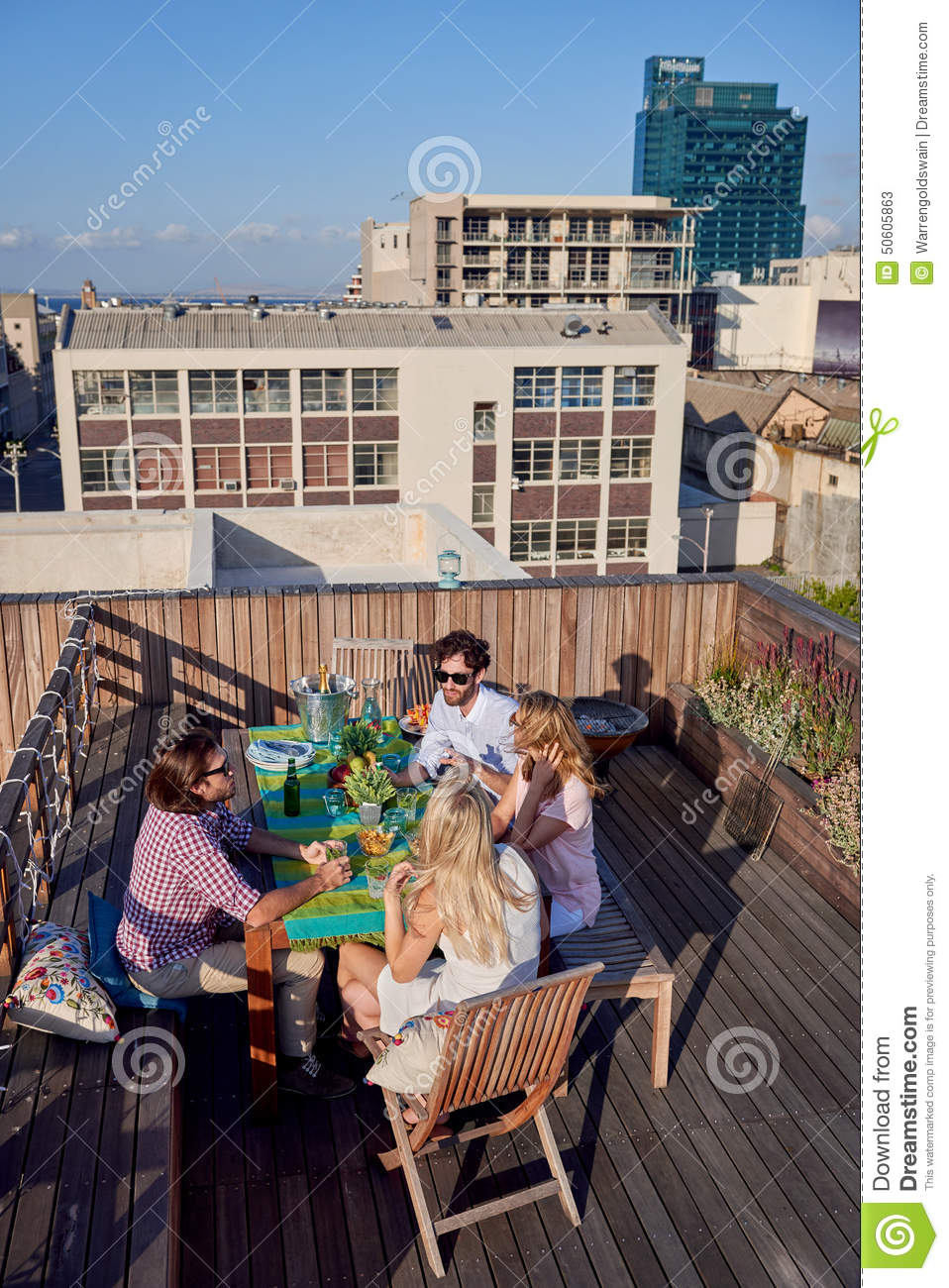 Friends party gathering on rooftop stock photo image for The terrace group