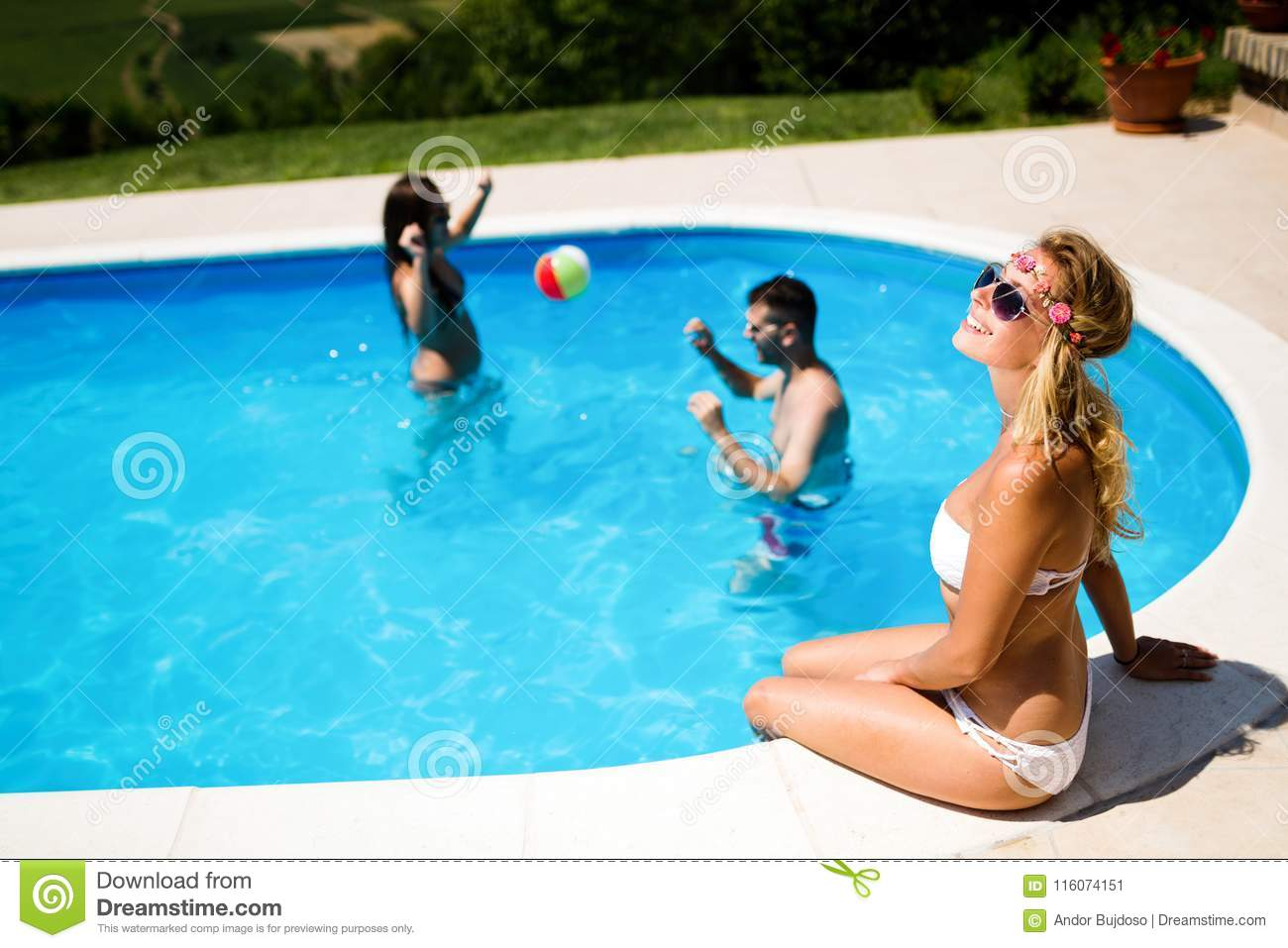 Friends Playing Ball Games In Pool Stock Image - Image of play ...