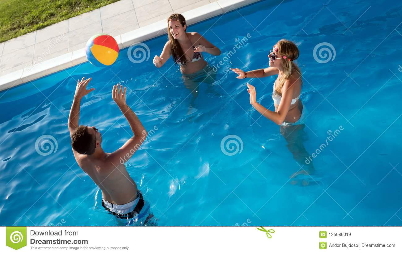 Friends Playing Ball Games In Pool Stock Image - Image of ...