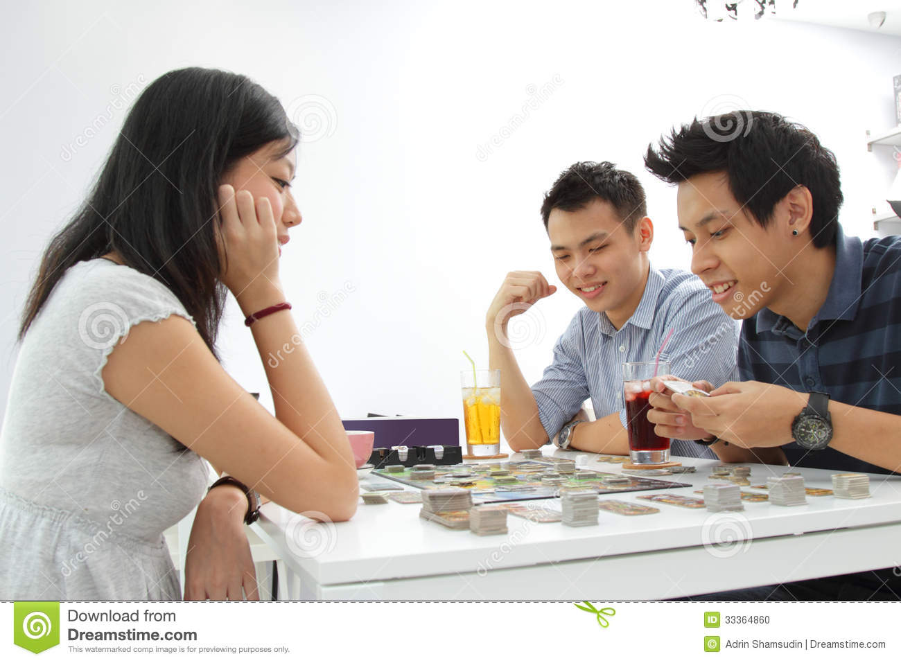 Friends Playing Board Game Stock Photo - Image: 33364860