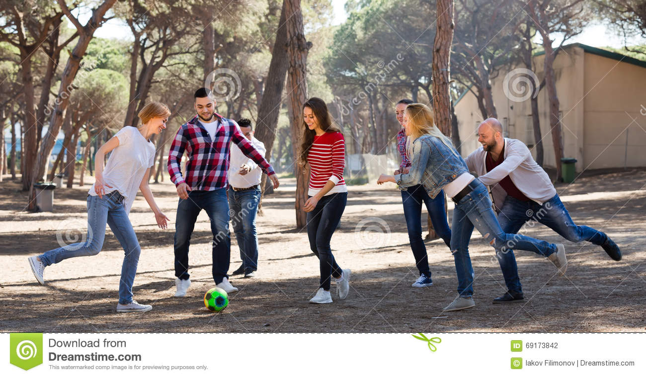 Friends Playing Football Stock Photo - Image: 69173842