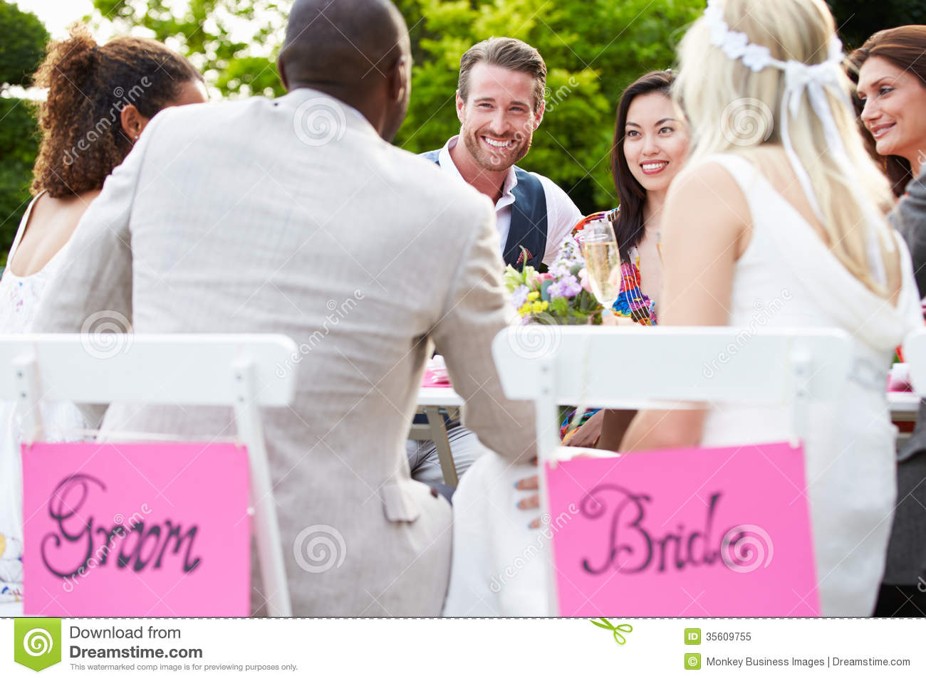 Friends Proposing Champagne Toast At Wedding
