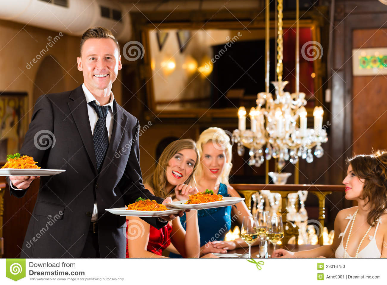 friends in restaurant waiter served the dinner stock photo image