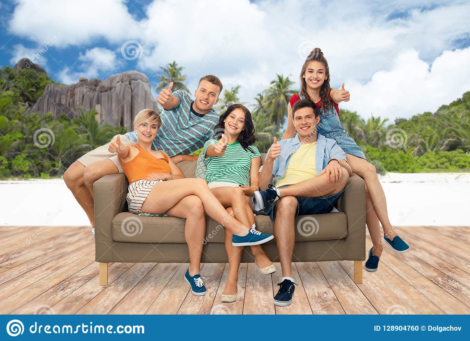 Friends Showing Thumbs Up Over Seychelles Island Stock Photo