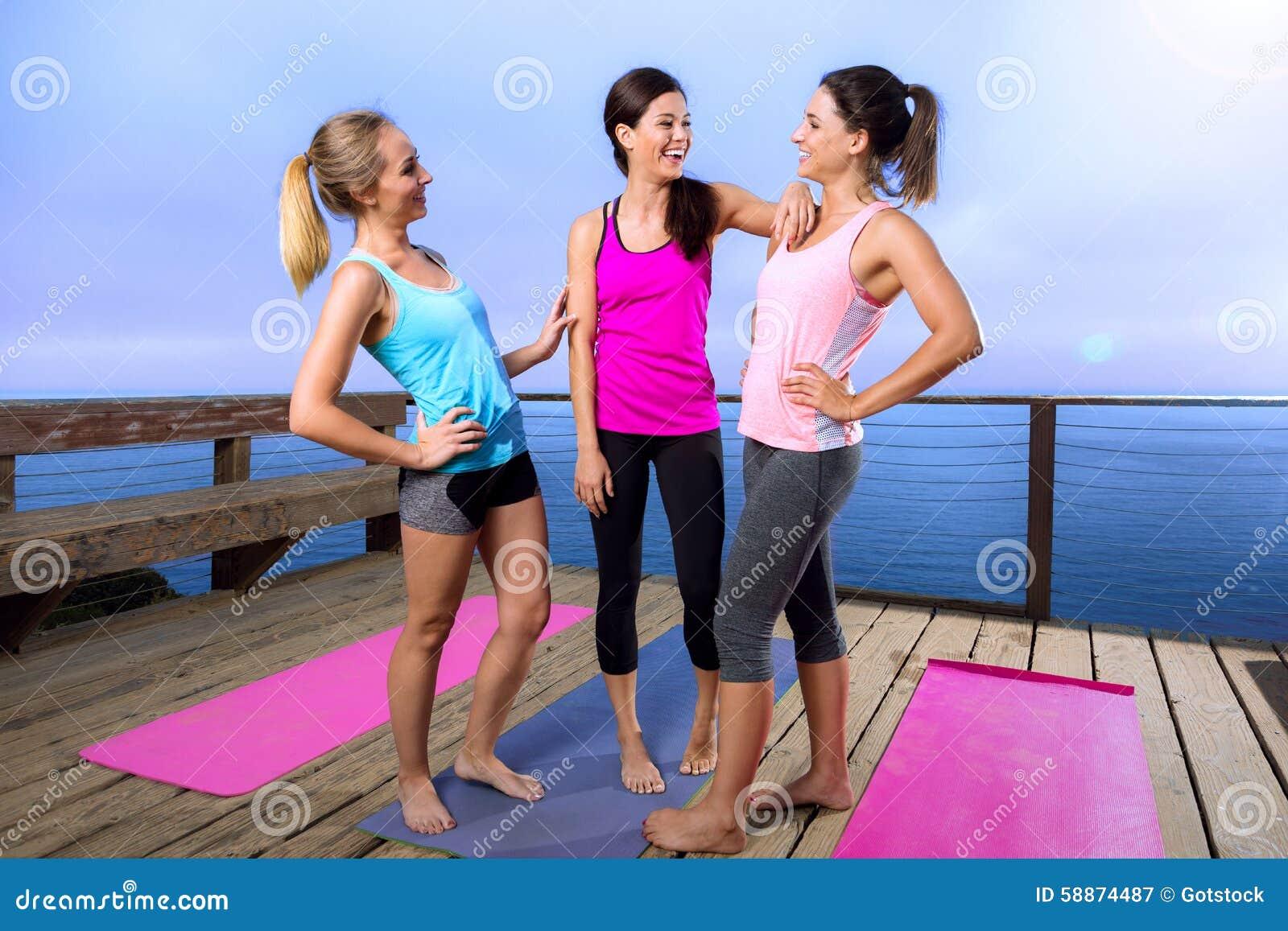 friends spiritual bond yoga classmates laugh casual conversation friendly before class stock. Black Bedroom Furniture Sets. Home Design Ideas