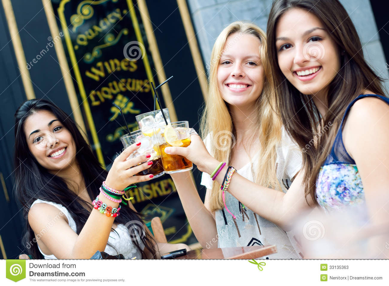 Friends taking a drink on a terrace stock photos image for The terrace group