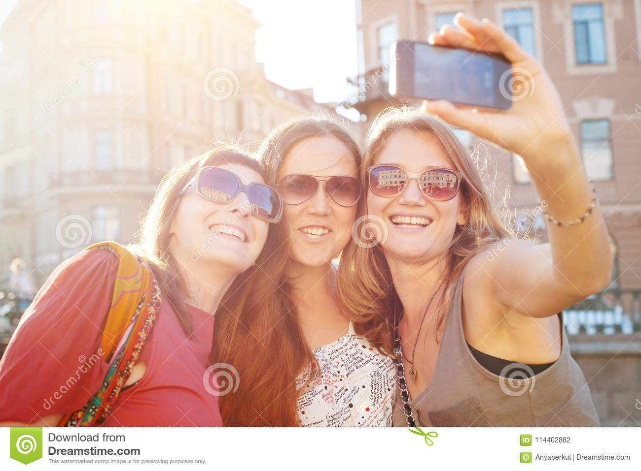 Friends taking selfy, students travel to Europe, girls selfie