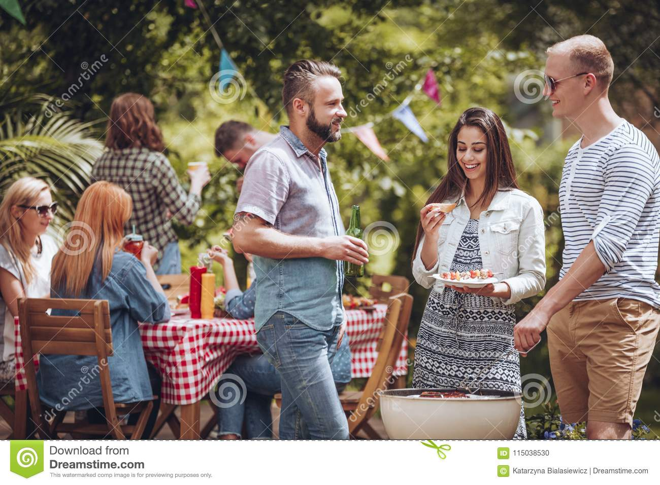 Friends talking over grill