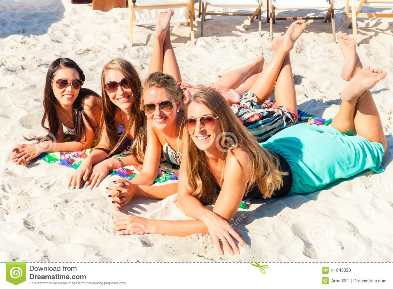 Lying on the beach with friends
