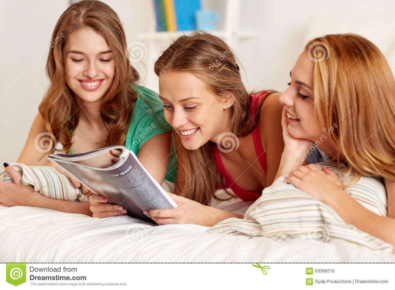 Friends or teen girls reading magazine at home stock photo for Home teen pics