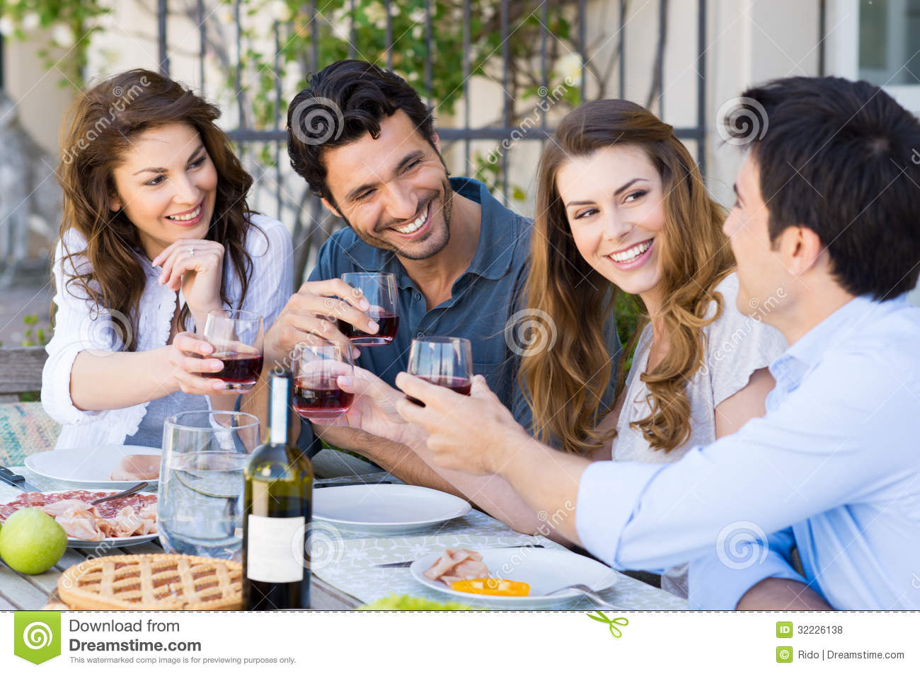 Friends toasting wine glass royalty free stock photos for Group lunch