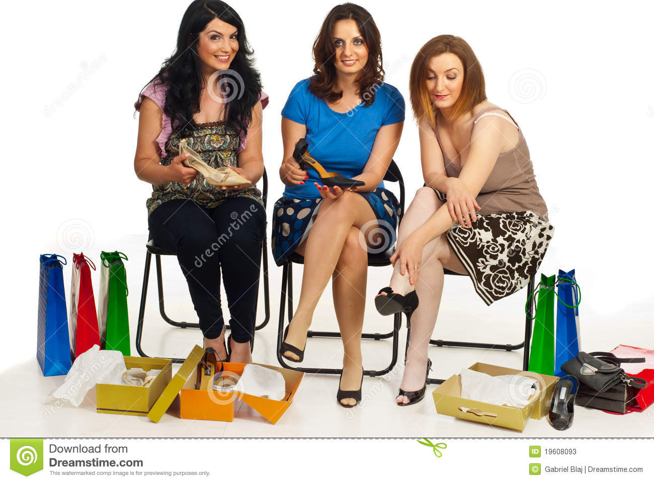 Happy three women shopping shoes and sitting on chairs to