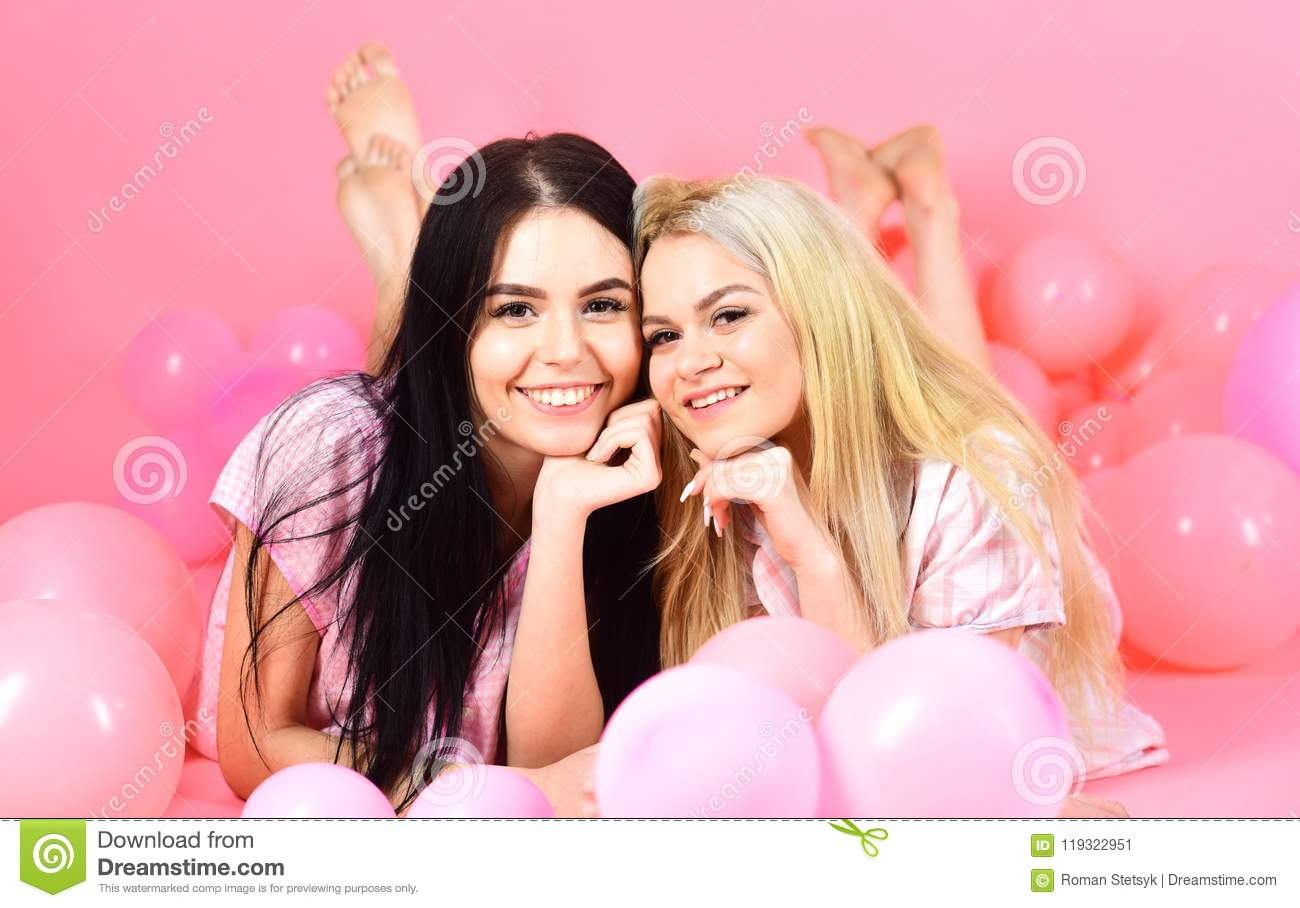 d15bea6a Friendship Concept. Blonde And Brunette On Smiling Faces Have Fun At ...