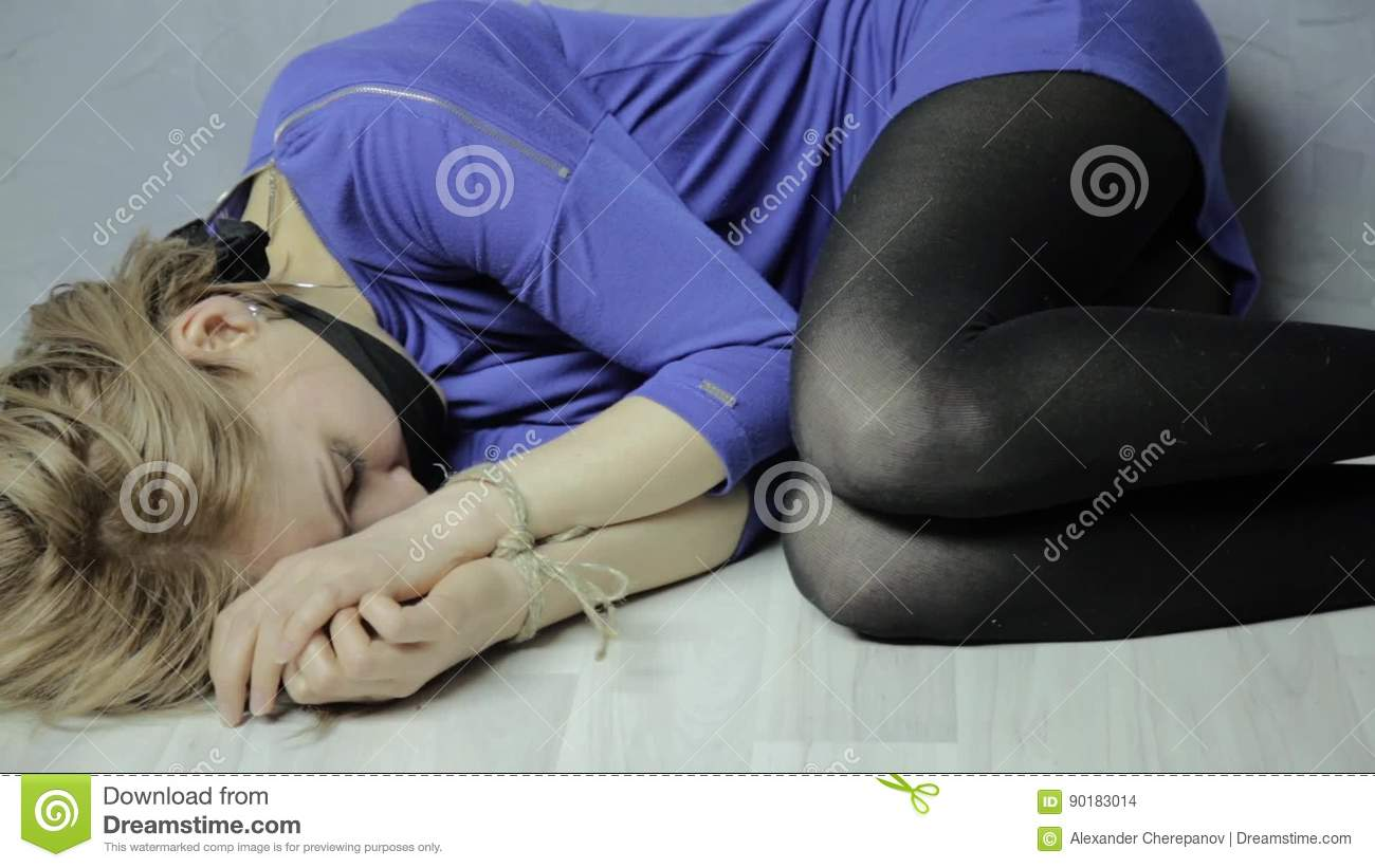 Frightened Cries Girl Gagged Lies On The Floor With Tied Hands Kidnapping And Violence Stock Footage Video Of Depression Curled 90183014