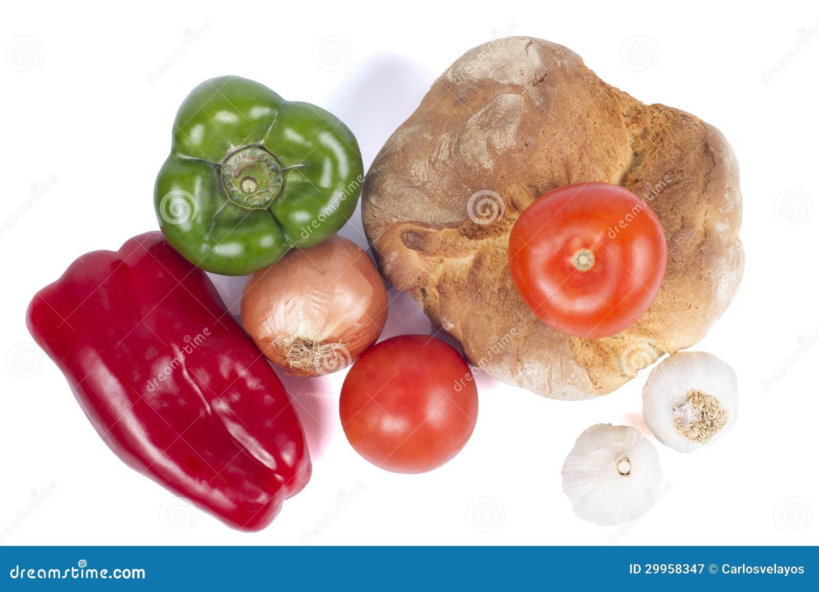 Frisches Brot mit Pfeffern, Tomaten, Zwiebel und Knoblauch.