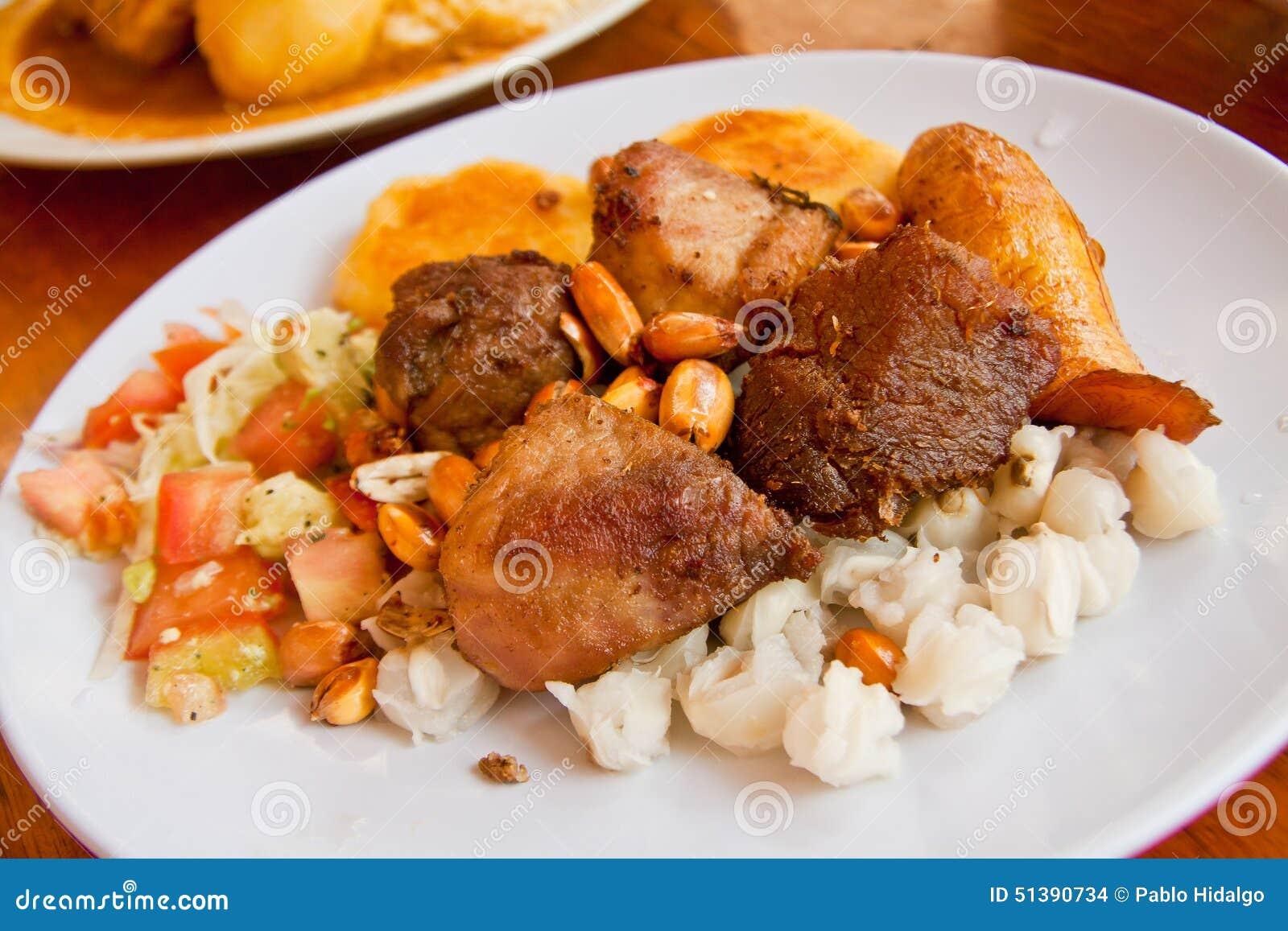 Fritada, cerdo frito, plato típico del ecuadorian