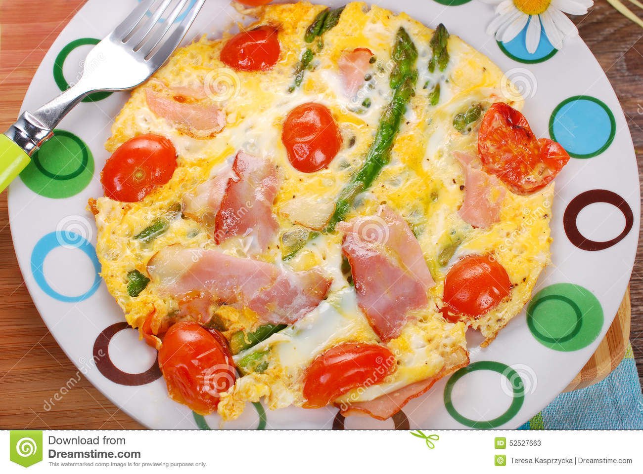 Frittata omelet with green asparagus,cherry tomato and smoked ham on ...
