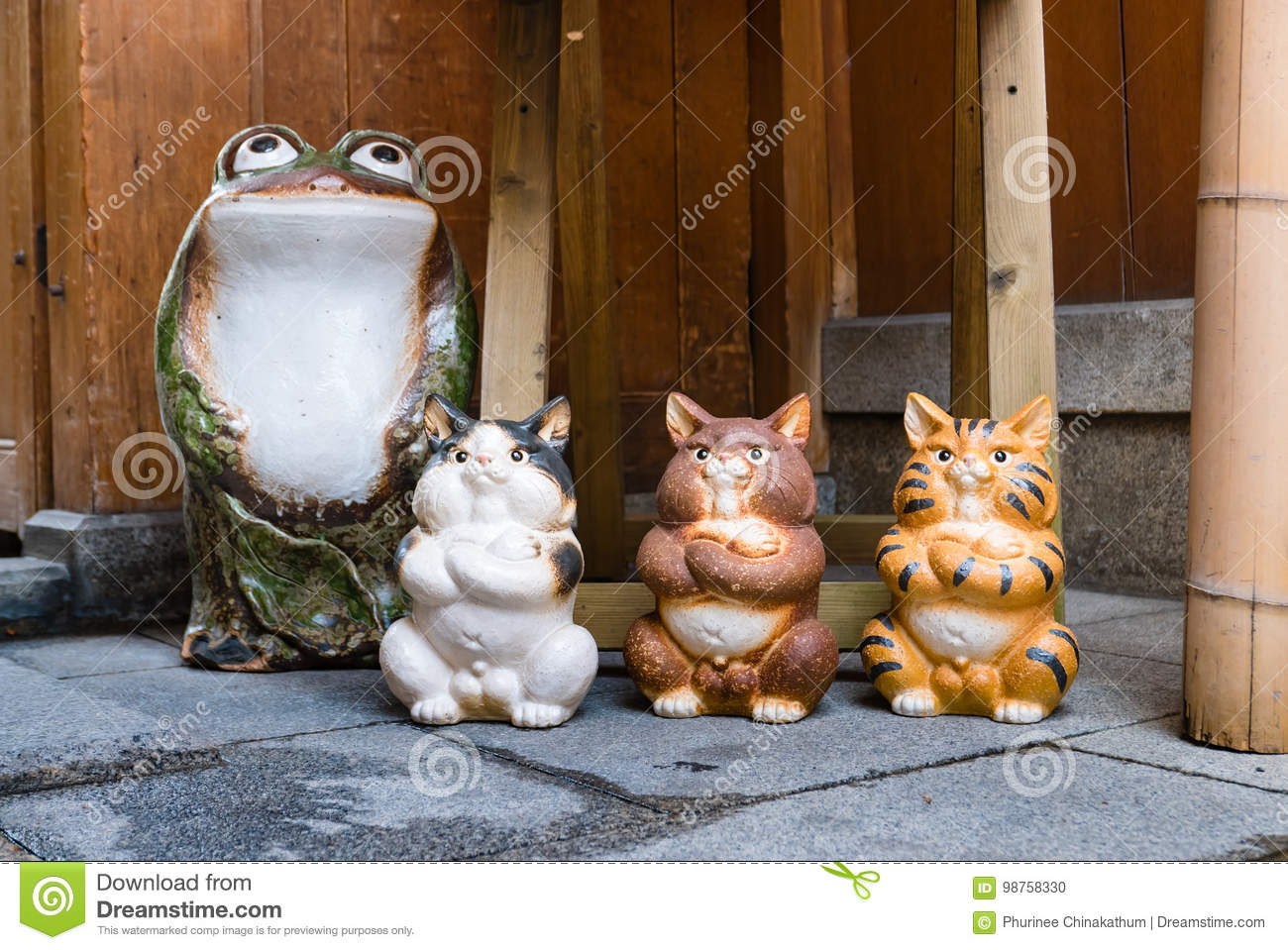 Frog and cats statue stock photo. Image of concept, green - 98758330