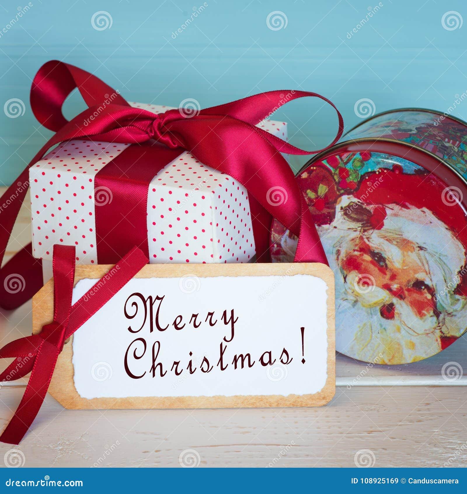 Frohe Weihnacht-Karte Mit Einer Weinlese Santa Candy Tin Und Rotes ...